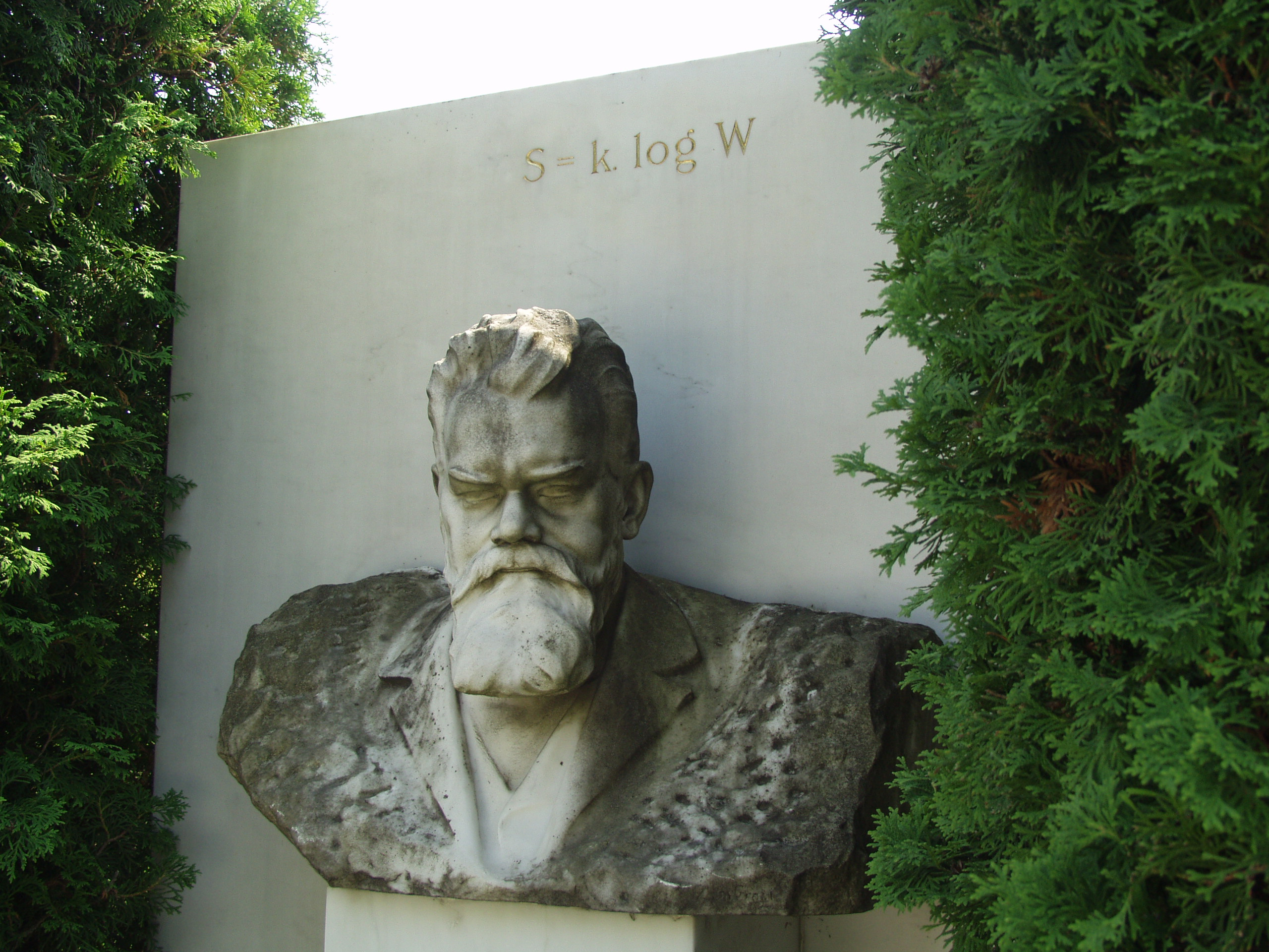 Vienna, Austria. Boltzmann's Tomb in the Zentralfriedhof (Central Cemetary). The Tomb is in Gruppe 14 C Grab No 1 (group 14 grave number 1). Photos by Tom Schneider or of him by Gerd Muller. 2002 July 14. This image: bust of Boltzmann.